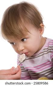 happy baby girl eating isolated
