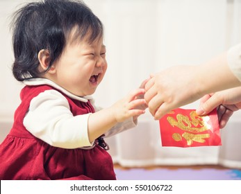 "happy baby girl get red envelope with ""FU"" means lucky for her first Chinese new year"