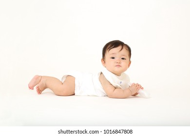 Happy baby girl portrait on white background looking at camera