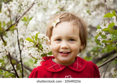 Happy  baby girl  in spring garden