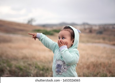Happy baby girl, surprise and delight. Emotional children. Knowledge of the world in travel.