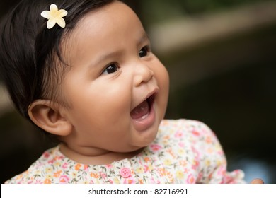 happy baby girl yelling her first words