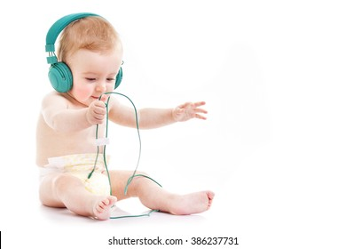 Happy baby with headphones on white background