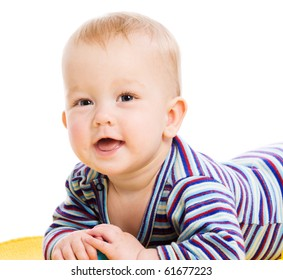 Happy Baby lying on towel isolated on white