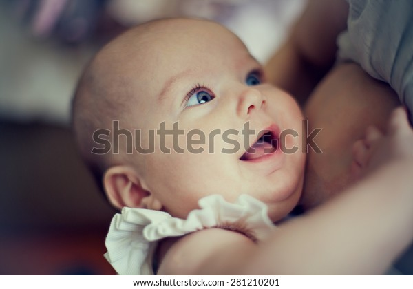 happy baby in the mother's breast
