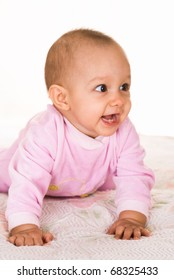 happy baby in pink on a white background
