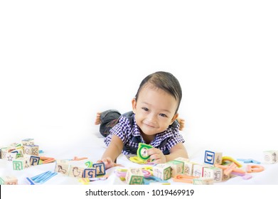 Happy baby playing with alphabet blocks isolated on white background. 7 Months baby. Development, progress and education concept or others your content.