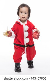 Happy baby in Santa Claus clothes on the white background.
