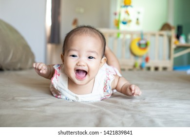 The happy baby is smiling