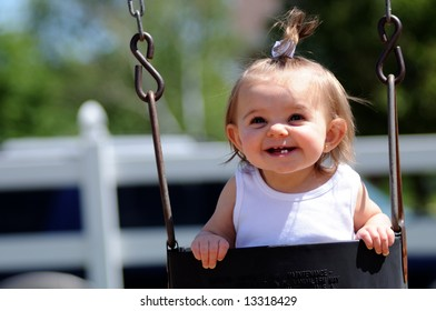 Happy baby in swing