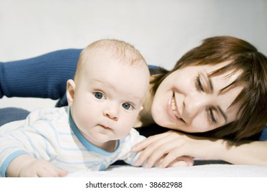 Happy baby-boy and Mom isolated on white