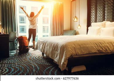 Photo of Happy backpacker traveller stay in high quality hotel