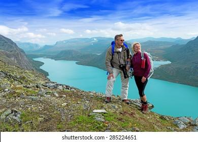 Happy backpackers at Besseggen ridge at Jotunheimen national park, Norway