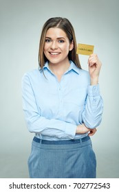 Happy bank employee woman holding golden credit card. Isolated studio portrait.
