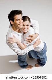Happy barefoot couple hugging