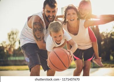 Happy basket family portrait. Close up.