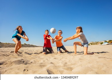 Happy beach volleyball players making forearm pass