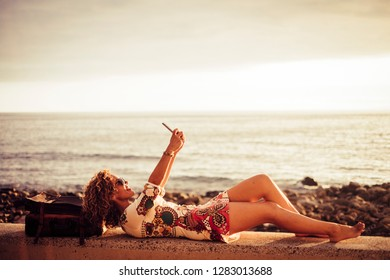 Happy beaitufl middle age woman caucasian take selfie picture to send and share with online friends on social media - vacation and travel enjoyment concept - sea horizon and freedom people