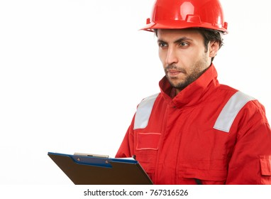 Happy beard engineer construction worker in red safety uniform and hard hat, holding clipboard isolated on white background with copy space, close-up portrait