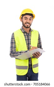 Happy beard engineer smiling and holding a clipboard, guy wearing caro shirt and jeans with yellow vest and yellow helmet, isolated on white background