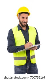 Happy beard engineer smiling and taking some notes, guy wearing dark blue shirt and jeans with yellow vest and yellow helmet, isolated on white background