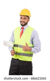 Happy beard engineer with a yellow helmet smiling and thumbs up, guy wearing white shirt and black trousers with yellow vest and red tie, isolated on white background