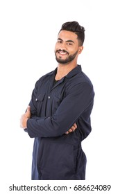 Happy beard worker smiling and standing confidently, guy wearing dark blue workwear, isolated on white background