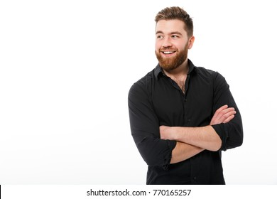 Happy bearded business man in shirt with crossed arms looking away over white background