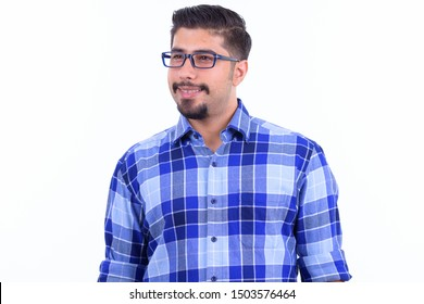 Happy bearded Persian hipster man with eyeglasses thinking