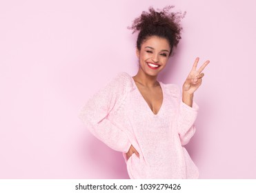 5d695a9df51a Happy beautiful african american girl with amazing toothy smile posing in  fashionable sweater. Young girl