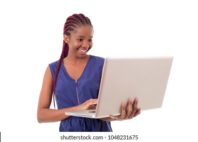 happy beautiful african businesswoman working with a laptop, isolated on white background