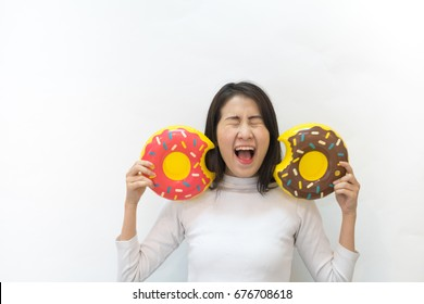 Happy beautiful Asian girl with mini donut float on her hand with cute smile have copy space on white background.
