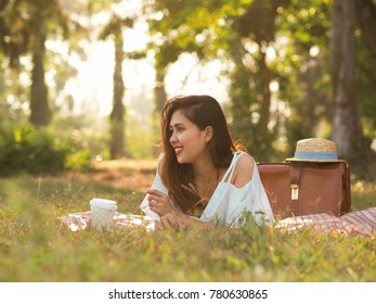 Happy Beautiful Asian woman in the field,travel concept.
