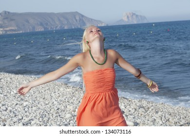Happy beautiful blonde girl on vacations on the sea