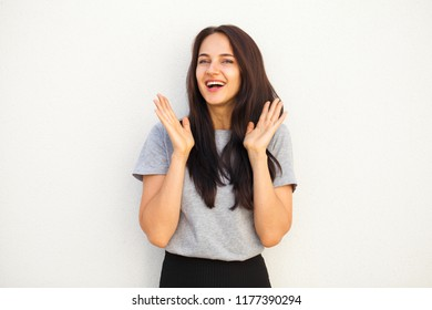 Happy Beautiful brunette woman in gray t-shirt, isolated on white wall background