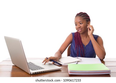 happy beautiful business woman working with a laptop on a desk, isolated on white background