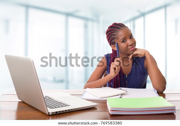happy beautiful business woman working with a laptop on a desk, at the office