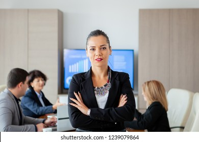 Happy beautiful bussines woman in conference room. Successful woman.