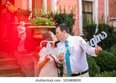 """happy beautiful couple holding """"the story begins"""" letters"""