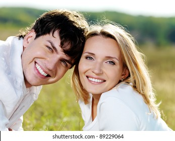 Happy beautiful couple on nature
