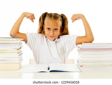 Happy beautiful cute with blond hair little schoolgirl likes studying and reading books in creative education concept with Back to school theme isolated on white background.