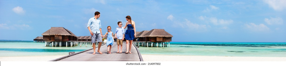 Happy beautiful family during summer vacation at luxury resort wide panorama with copy space, perfect for banners