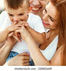 Happy beautiful family on sunset smiling