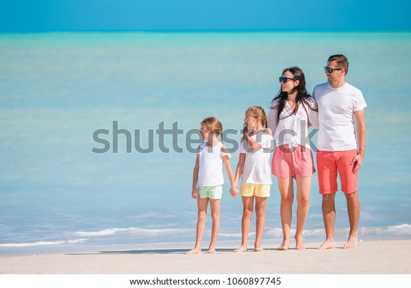 Happy beautiful family on tropical beach vacation