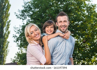 Happy beautiful family posing in nature