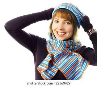 happy beautiful ginger girl wearing a hat and scarf isolated against white background