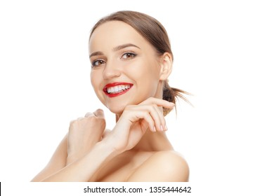 Happy beautiful girl with crossed hands near chin laughing and looking joyfully. Teeth and skin care.