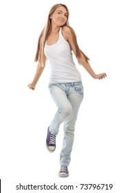 Happy beautiful girl dancing and celebrating standing in full length, isolated on white background