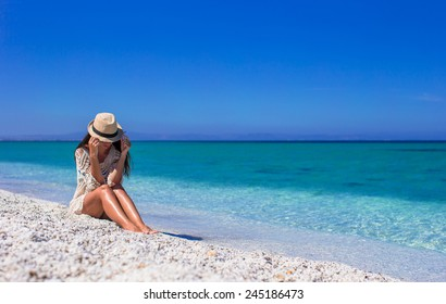 Happy beautiful girl during beach tropical vacation