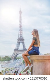 Happy beautiful girl having fun in centre of Paris. Background of Eiffel tower. Travel concept